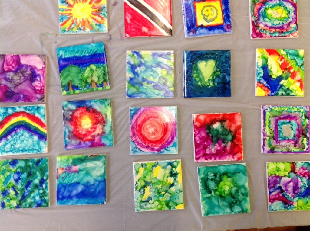 These are handpainted ceramic tiles that can be used as coasters.
